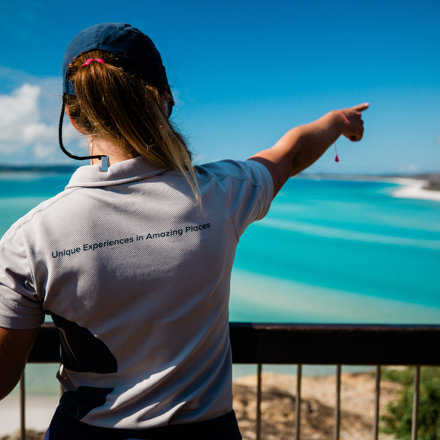Explore staff member pointing out Hill Inlet in the Whitsundays
